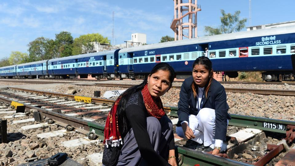Neelam Jatav (right) with a colleague working on a railway track at the Gandhinagar railway station in Jaipur. Gandhinagar is India's only interstate train station run entirely by women.  India is one of the world's fastest growing major economies but also has one of the lowest rates of female employment, and the trend is worsening.