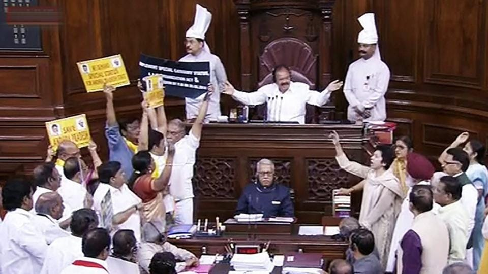 Rajya Sabha chairperson M Venkaiah Naidu gestures as opposition members protest during the on-going Budget Session of Rajya Sabha, at Parliament House in New Delhi on Thursday.