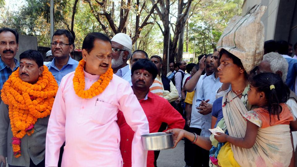 A woman beggar seeking alms from  a candidate contesting civic polls in Ranchi