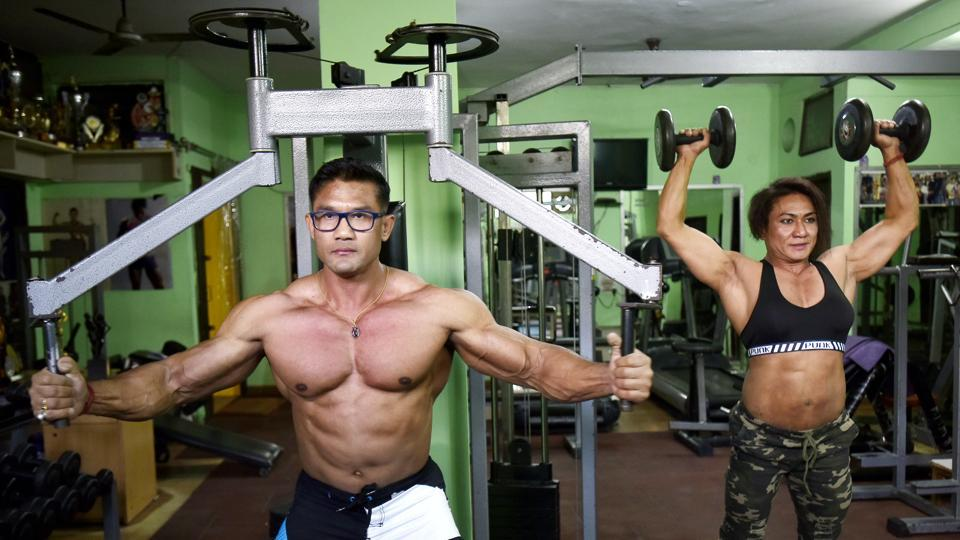 Borun Yumnam (L), a Central Reserve Police Force (CRPF) inspector from Manipur leads a brigade of 17 CRPF constables in a gymnasium near Mehrauli, Delhi. An acclaimed bodybuilder, Yumnam and his wife Mamota (R) have been training CRPF bodybuilders for the 11th Mr. India, Senior Men's and Women's Body Building Championship – being held March 23-25, 2018 in Pune. (Raj K Raj / HT Photo)