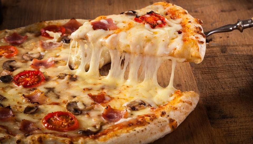 The chef used 111 different types of cheese on the pizza.