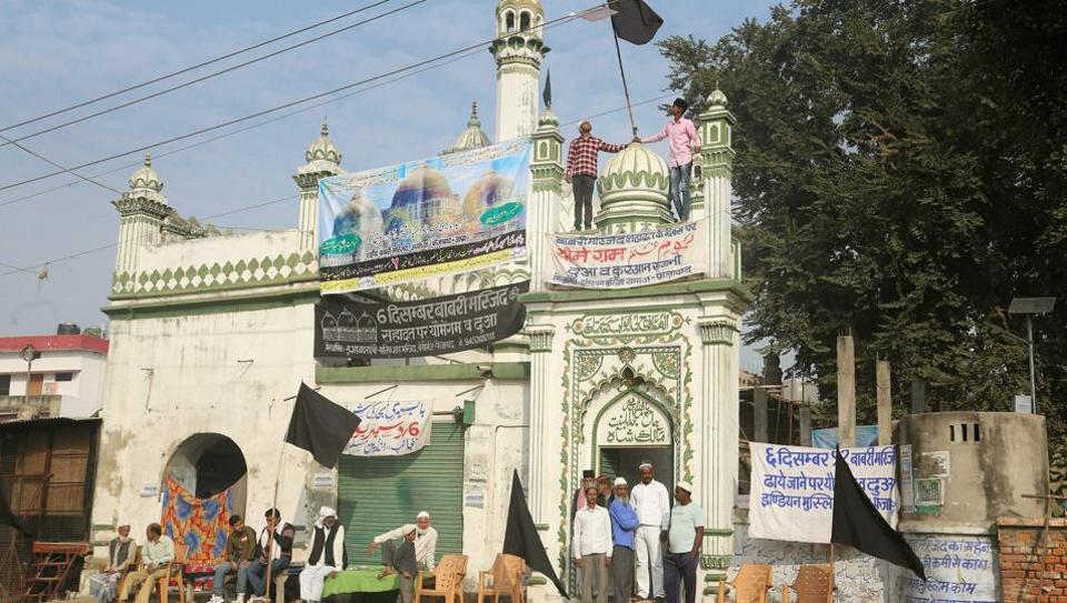 People protest on the anniversary of Babri Masjid demolition, in Ayodhya.