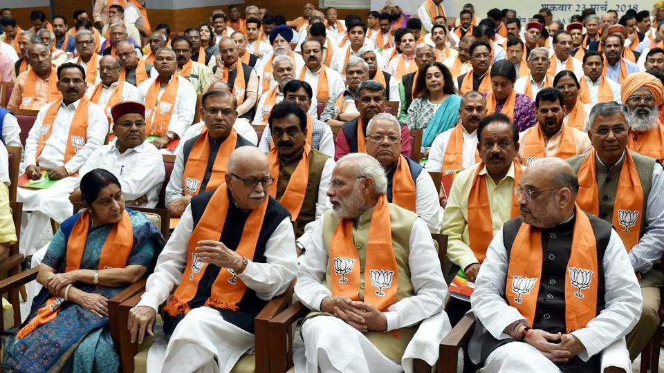 Prime Minister Narendra Modi talks with BJP senior leader LK Advani as BJP president Amit Shah and external affairs minister Sushma Swaraj look on during the party's parliamentary party meeting at party headquarters in New Delhi on Friday.