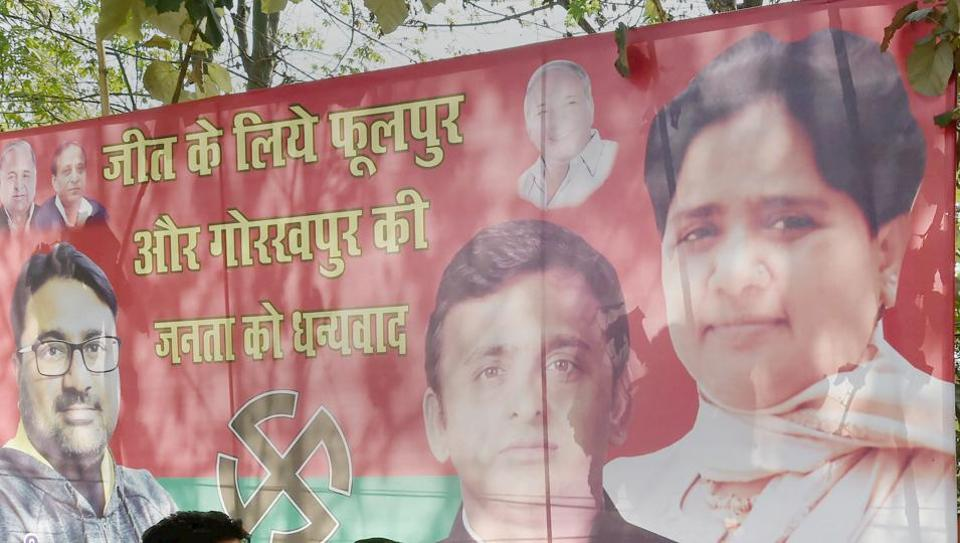 A poster of Bahujan Samaj Party supremo Mayawati and Samajwadi Party chief Akhilesh Yadav outside the Samajwadi Party's office in Lucknow.