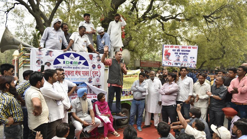 Drivers of Ola and Uber cabs protest at Parliament Street in New Delhi, on Thursday.