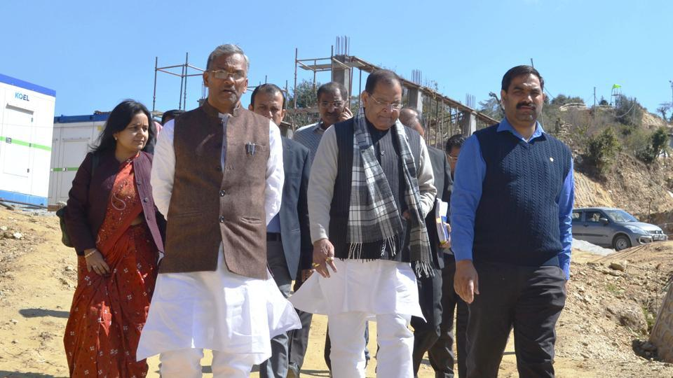 Chief minister TS Rawat (2nd from left) on Saturday inspects residential buildings being constructed for ministers, legislators and officials in Bhararisain (Gairsain).