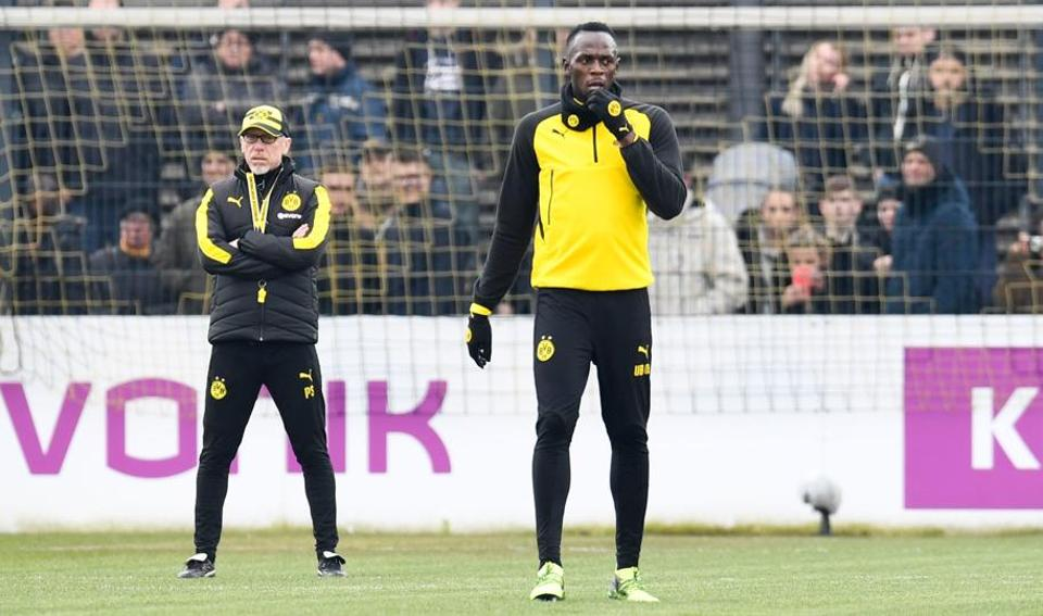 Sprinter, Bolt in Dortmund for soccer trial
