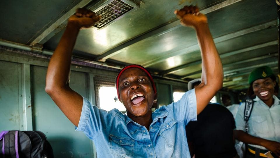 A female prisoner celebrates with songs in the back of a prison's truck as she was released from the Chikurubi Prison, in Harare, Zimbabwe on March 22, 2018. Zimbabwean President Emmerson Mnangagwa, who succeeded ousted Robert Mugabe in November 2017, has pardoned at least 3,000 prisoners to clear out overpopulated jails of the country. (Jekesai Njikizana / AFP)