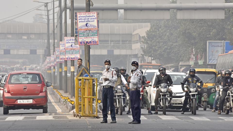 Traffic policemen at ITO in New Delhi.