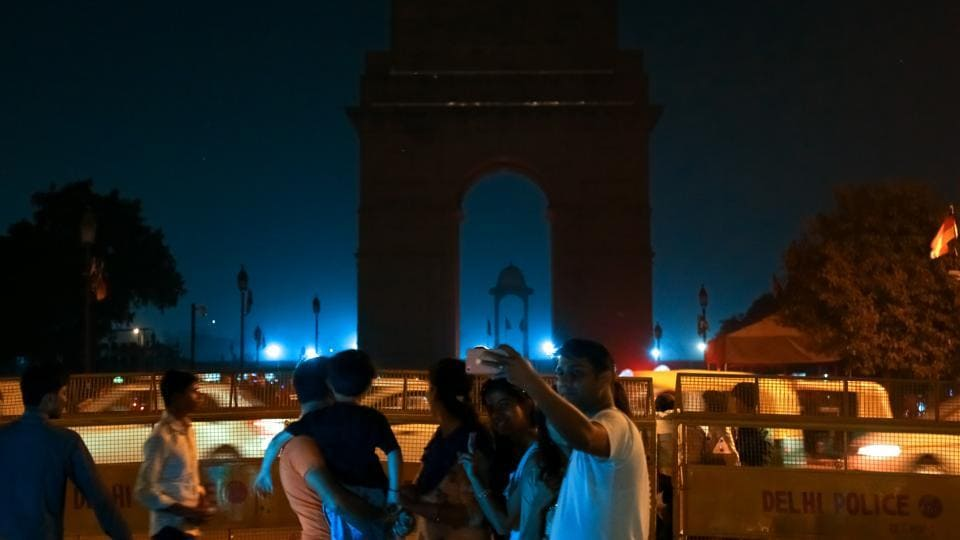 Visitors take selfies at India Gate, which went dark for Earth Hour 2018. To observe the hour, lights at Delhi monuments were  switched off  between 8.30 pm and 9.30 pm on Saturday, March 24.