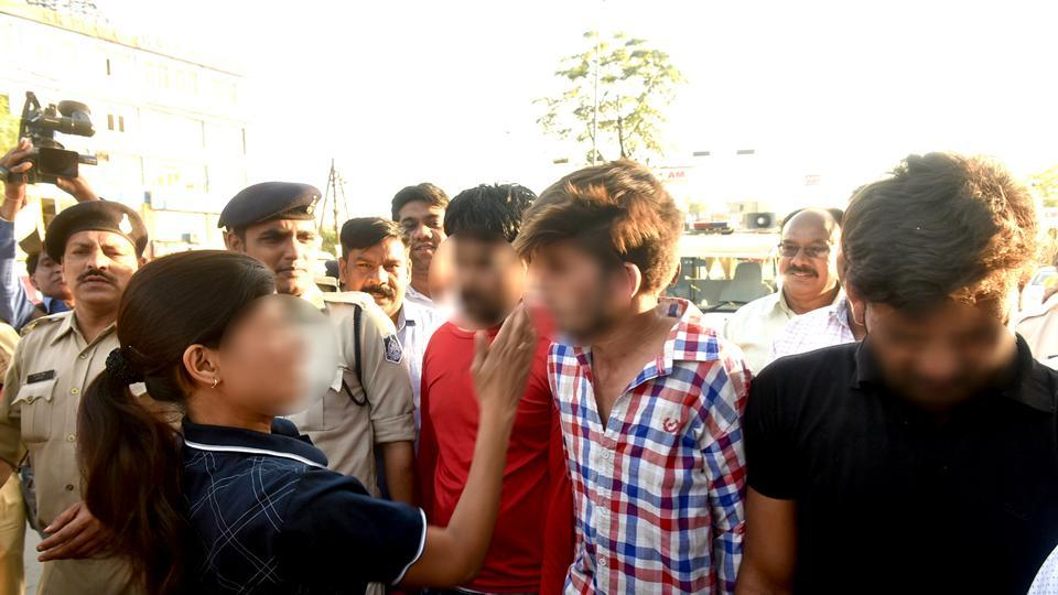 Police arrested four men accused of raping a woman and paraded them through Bhopal's streets.