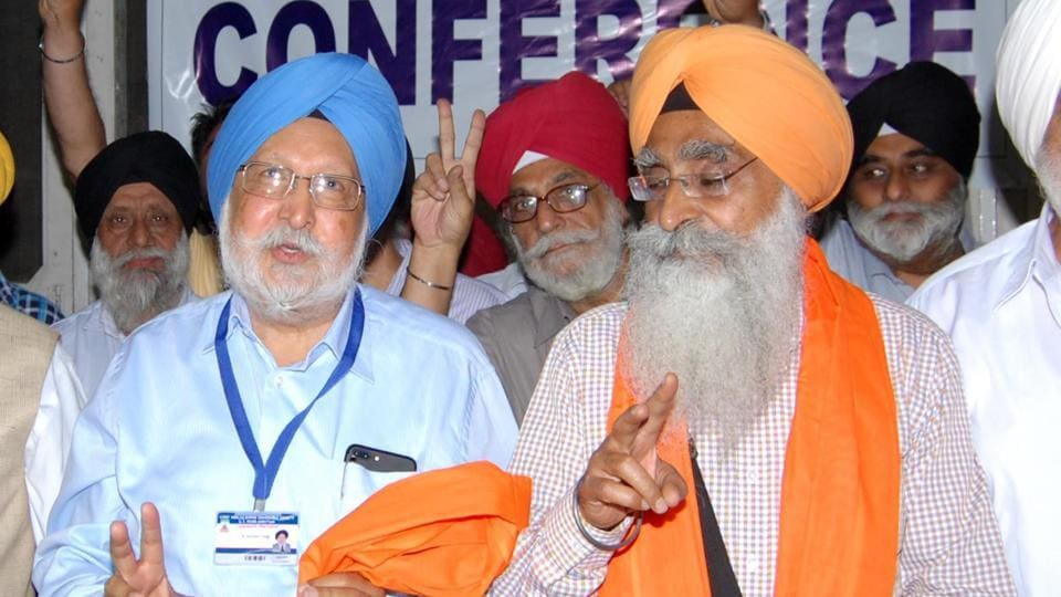 Newly elected president of Chief Khalsa Diwan, Dr Santokh Singh (left) and vice president Sarabjeet Singh after winning the election in Amritsar on Sunday.