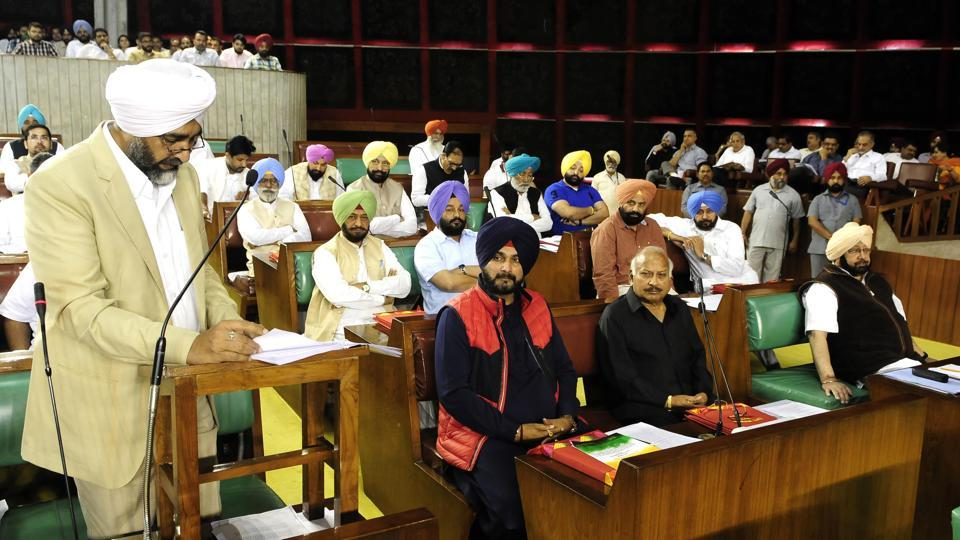 Punjab finance minister Manpreet Singh Badal presenting the annual budget as members on treasury benches look on at the assembly in Chandigarh on Saturday.