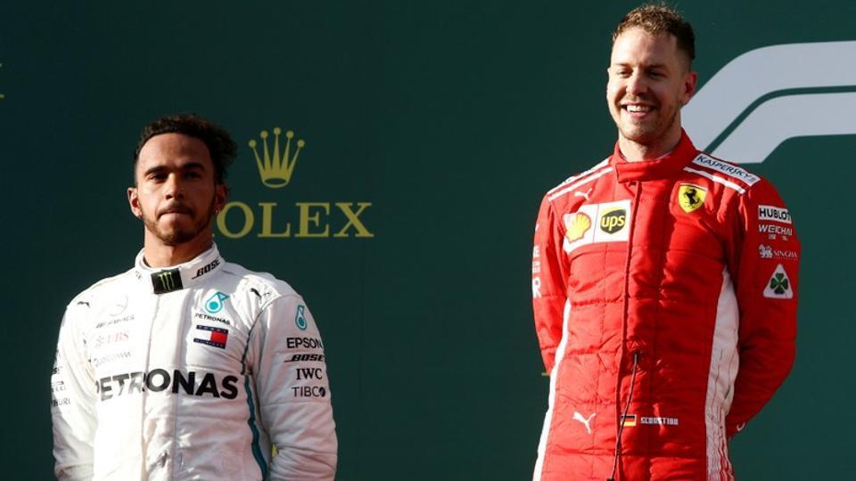 Ferrari's Sebastian Vettel (R) celebrates his Australian Grand Prix win on the podium with Mercedes' Lewis Hamilton.  (REUTERS)