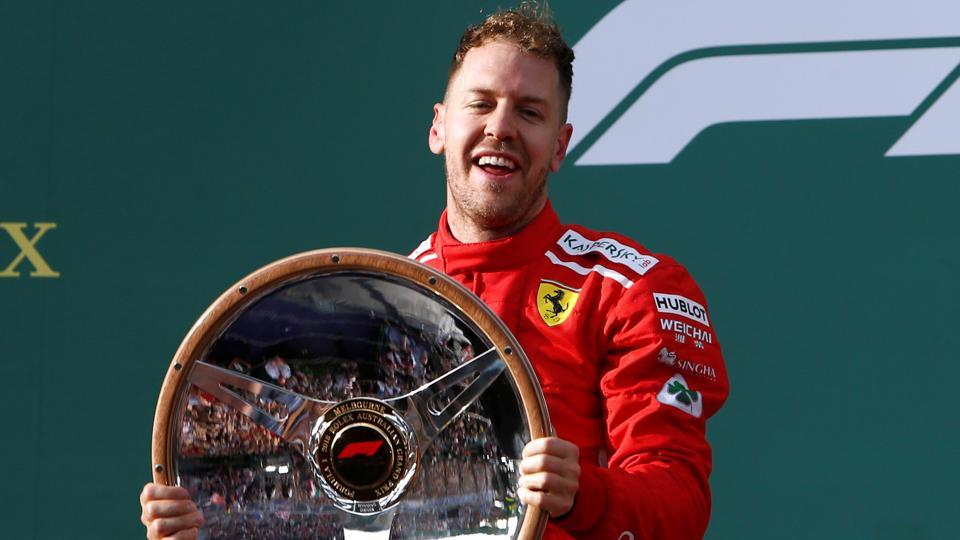 Ferrari's Sebastian Vettel celebrates his Formula 1 Australian Grand Prix win in Melbourne on Sunday.