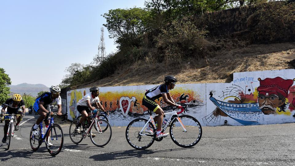 Cyclists navigate through the  Bhor ghat on the Mumbai-Pune highway during the 52nd Giant-Starkenn Mumbai-Pune Cycle Race.