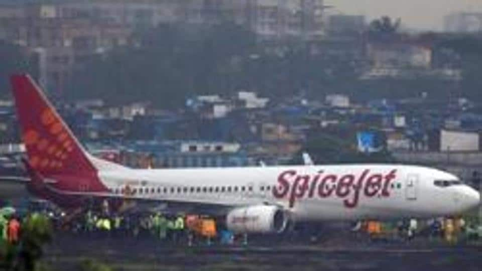 A SpiceJet passenger aircraft Boeing 737-800 is seen after it overshoot the runway while landing on Tuesday night at the airport in Mumbai, India.