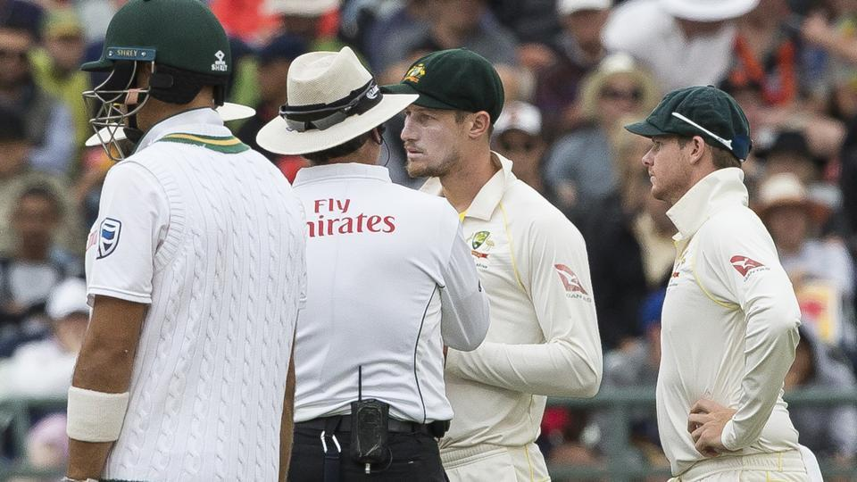 Australian cricket team's Cameron Bancroft (2R) and skipper Steve Smith (R) have come under fire for tampering the ball during the third day of the third Test against South Africa in Cape Town on Saturday.