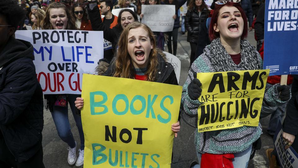 Protestors shout as they march down Sixth Avenue during the March For Our Lives, on Saturday, in New York City.