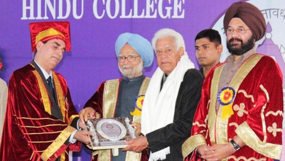 Former Prime Minister Dr Manmohan Singh honouring an alumnus of Hindu College in Amritsar on Saturday. Principal PK Sharma (2nd right) and Guru Nanak Dev University vice-chancellor Jaspal Singh Sandhu (right) are also seen in the picture.