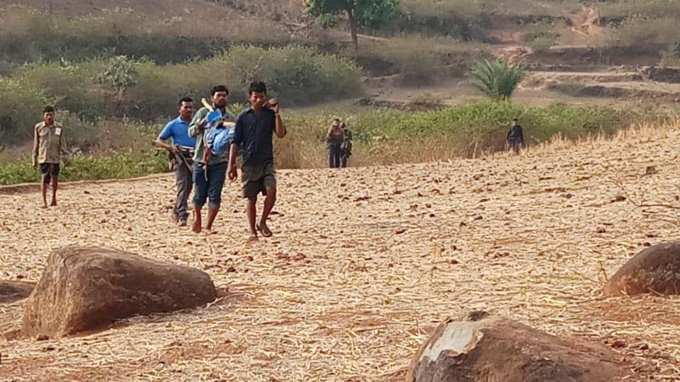 Policemen carry bodies of Maoists killed in an encounter in Koraput in Odisha on Sunday.