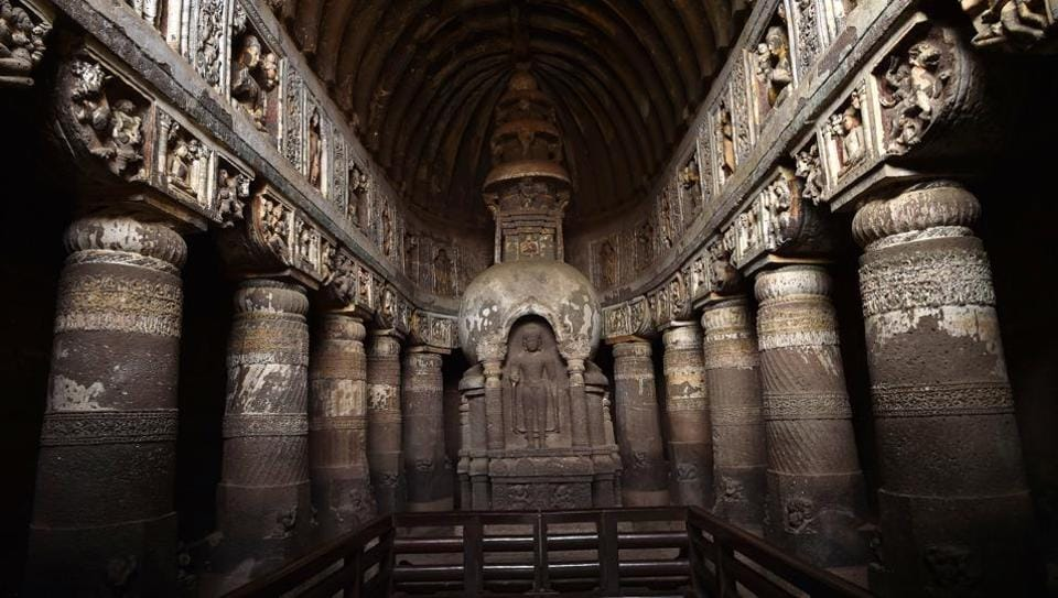 A view of the 5th century AD prayer hall in the Ajanta caves depicting the Buddha is various poses. History buffs visiting the 2,000-year-old rock-cut caves, armed with guidebooks explaining narratives behind its fabulous murals and sculptures which depict the lives and times of Buddha and Bodhisattvas are met with the extreme low-light conditions inside and the mystery of how painters managed this task in near darkness. (Ajay Aggarwal / HT Photo)