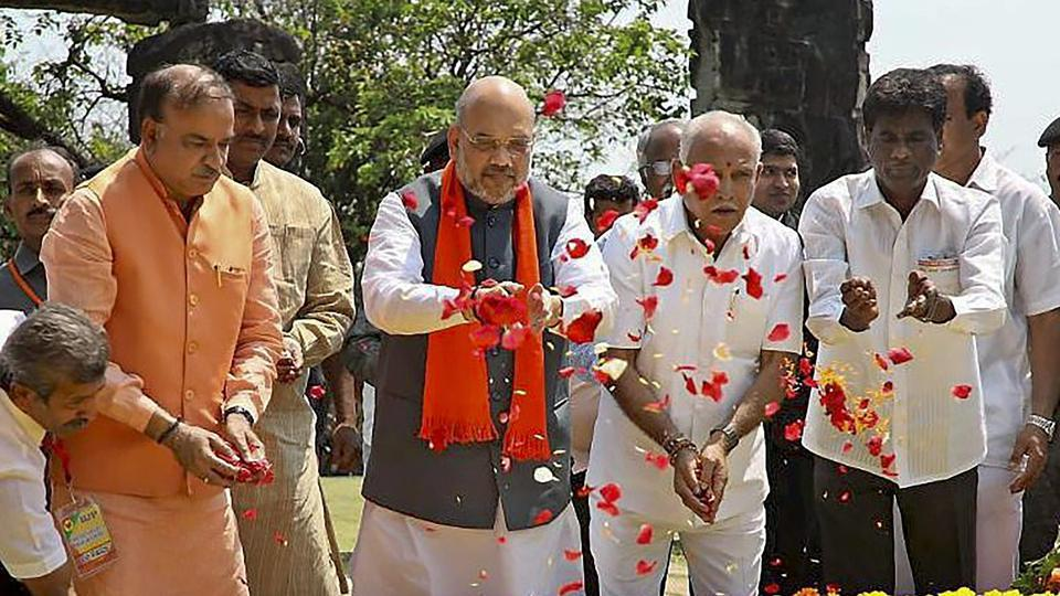 BJP president Amit Shah pays tribute to Kuvempu Smarak in Thirthahalli taluk of Shimoga district during his two-day Karnataka visit. Also seen is parliamentary affairs minister Ananth Kumar.
