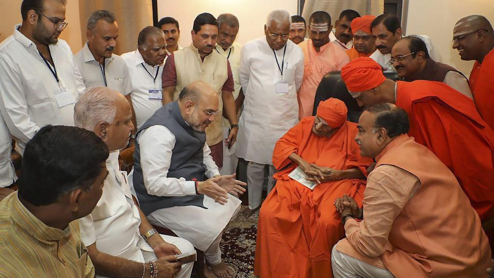 BJP national president Amit Shah began his two-day tour of Karnataka today by seeking blessings of Shivakumara Swamiji of Siddaganga, a prominent Lingayat spiritual guru. (PTI)