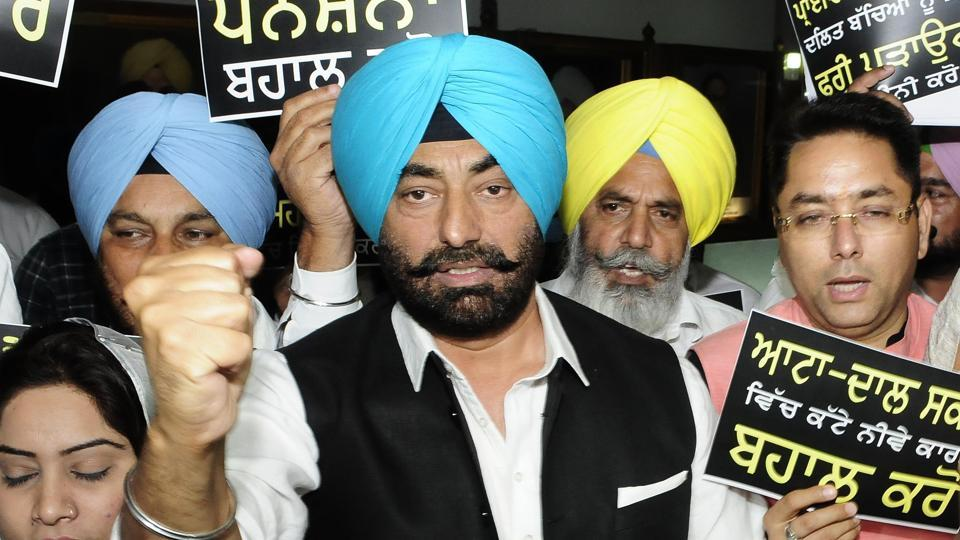 Opposition AAP legislators protesting outside Punjab assembly during budget session in Chandigarh on Monday.