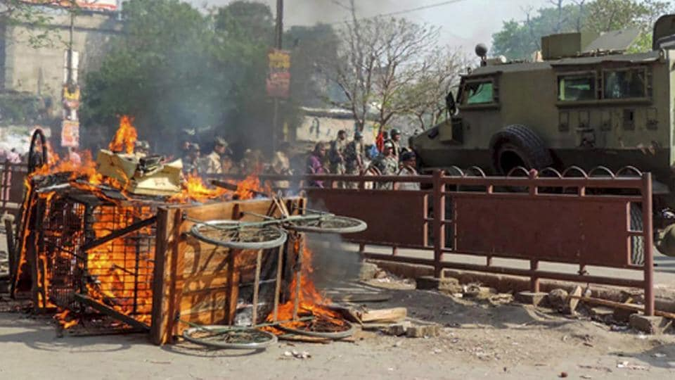 A scene of arson after clashes between two groups during a Ram Navami procession in Aurangabad on Monday.