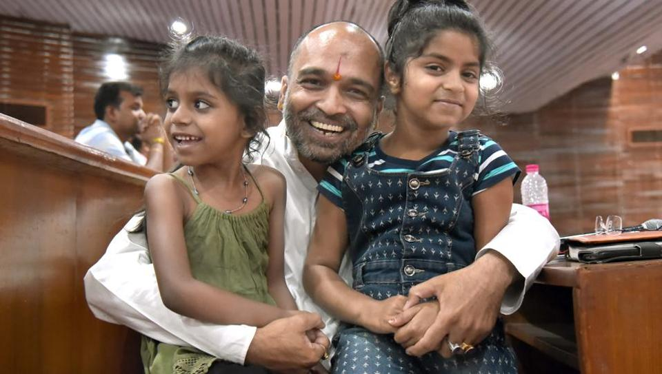 State advisor to Rajasthan government's Ashray Paalna Sthal Yojana, Devendra Agarwal with abandoned girls, who were adopted at a function in Jaipur on Monday. The function was organised to felicitate childless couples, who have adopted abandoned children from Ashray Paalna Sthals.