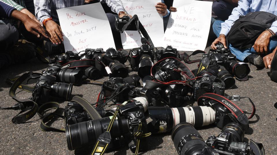 Journalists and photographers put their cameras down during a protest march from Press Club of India to Parliament House against the assault on journalists during the recent JNU students protests in New Delhi. (Raj K Raj / HT Photo)