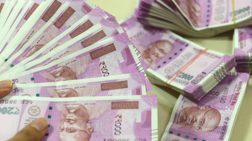 Rupee up nine paise against dollar on Fed rate hike