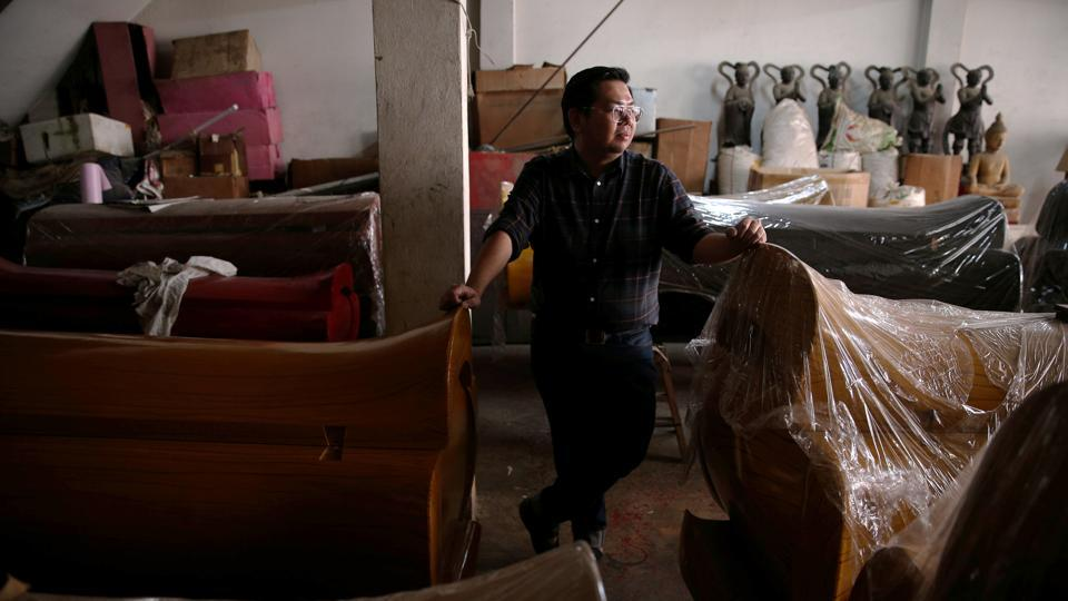 "Professionally, Assadayut has a more unassuming role running a business selling coffins in Bangkok's Chinatown. ""Natalia is a role model for many other Chinese sons still living in the closet,"" Assadayut said. (REUTERS)"