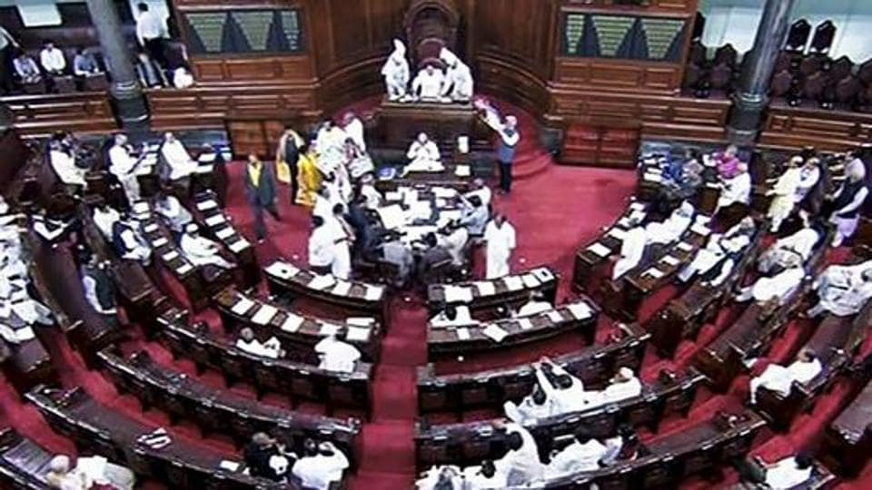Opposition members protest during the ongoing budget session of Rajya Sabha, at Parliament House in New Delhi.