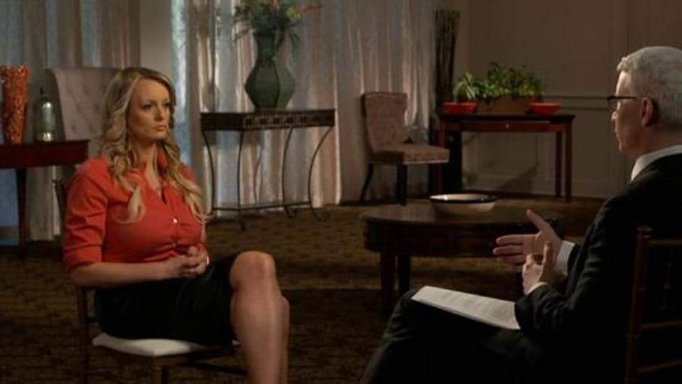 Stormy Daniels, an adult film star and director whose real name is Stephanie Clifford is interviewed by Anderson Cooper of CBS News' 60 Minutes program in early March 2018, in a still image from video provided March 25, 2018.
