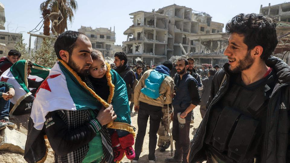 The deal with Faylaq al-Rahman, brokered by Russia and announced on Friday, provides for the evacuation of 7,000 rebels and civilians from the pocket of Ghouta it controlled. The deal also offered residents the option to stay as Ghouta fell to the regime. (Amer Almohibany / AFP)
