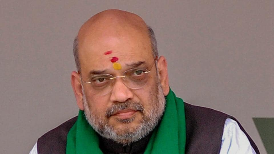 BJP president Amit Shah looks on during a statewide door-to-door campaign in Davanagere on Tuesday.