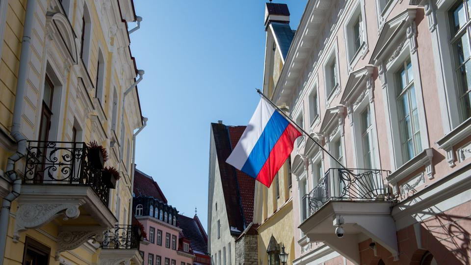 Russia's flag flutters in front of the Russian Embassy in Tallinn, Estonia, on March 27, 2018.