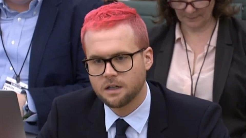A video grab from footage broadcast by the UK Parliament's Parliamentary Recording Unit (PRU) shows Canadian data analytics expert Christopher Wylie who worked at Cambridge Analytica appears as a witness before the Digital, Culture, Media and Sport Committee of members of the British parliament at the Houses of Parliament in central London on March 27, 2018 .