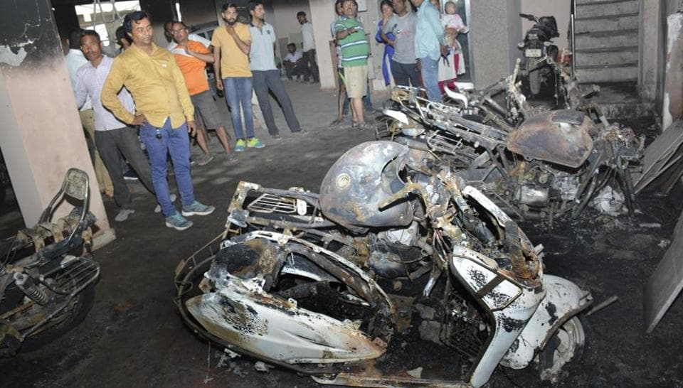 Ten bikes and a car were gutted at a residential building in Vijay Nagar early Tuesday.