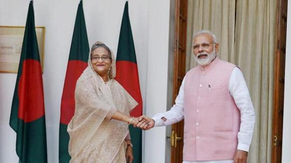 Prime Minister Narendra Modi shakesh hands with his Bangladeshi counterpart Sheikh Hasina before a meeting at Hyderabad house in New Delhi.