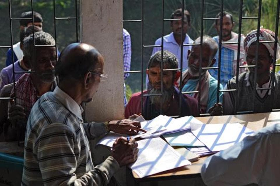 People wait to check their names on the first draft of the National Register of Citizens (NRC) at Goroimari of Kamrup district in Assam on January 1.