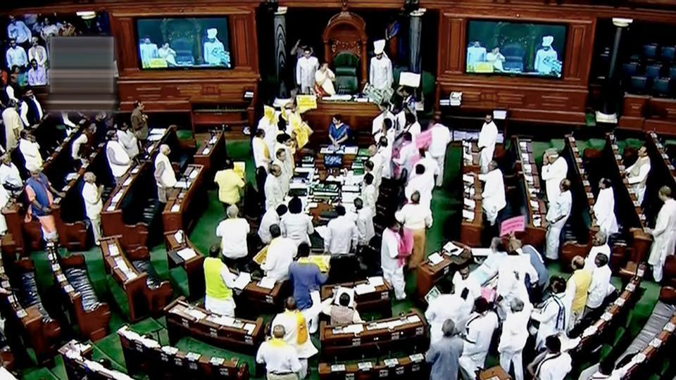Opposition members protest during the ongoing Budget Session of Parliament in the Lok Sabha on Monday.
