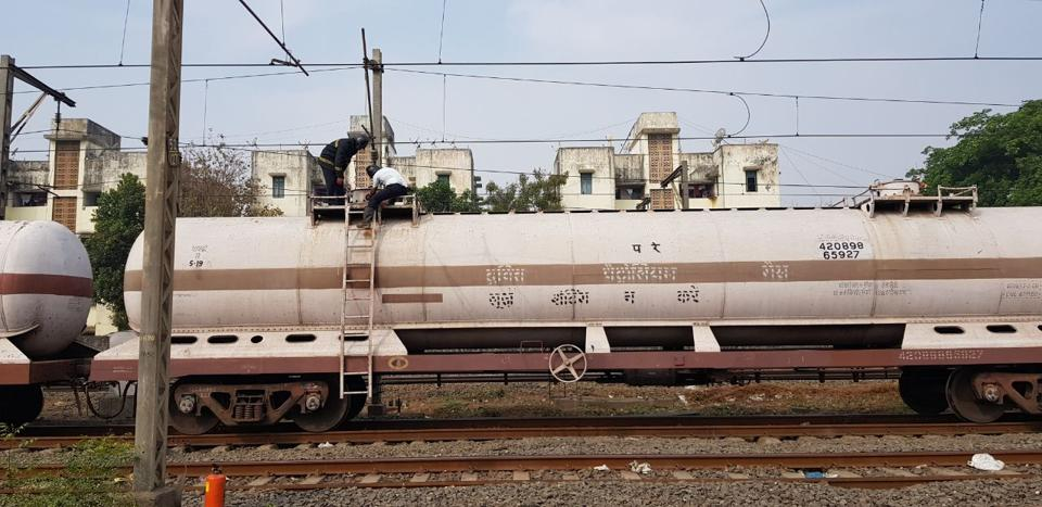 Fire brigade and IOC officials plugging gas leak in a container on a good train in Vasai on Wednesday.