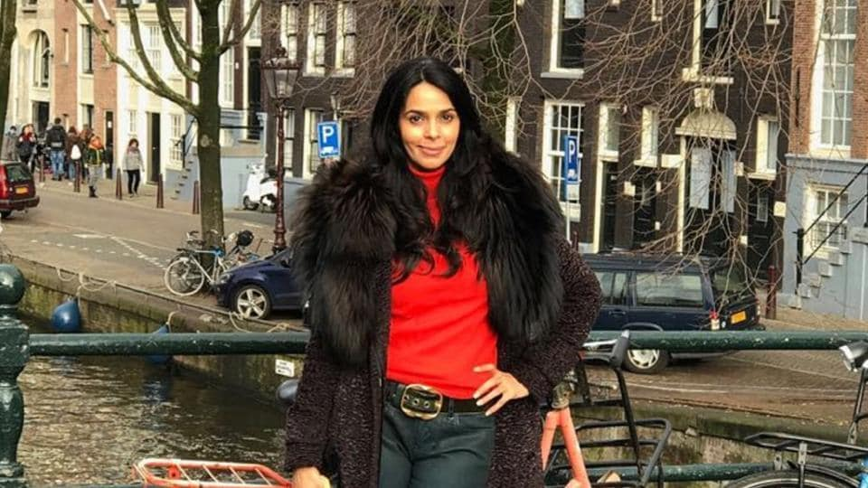 Actor Mallika Sherawat was on a work-cum-leisure trip to Amsterdam, and visited the tulip fields there.