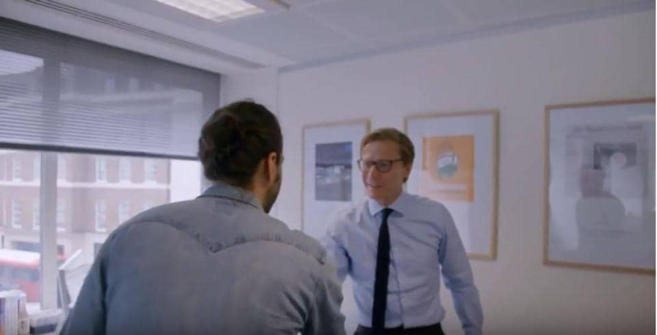 A scene from the documentary that shows the Congress party's poster behind former Cambridge Analytica CEO Alexander Nix.