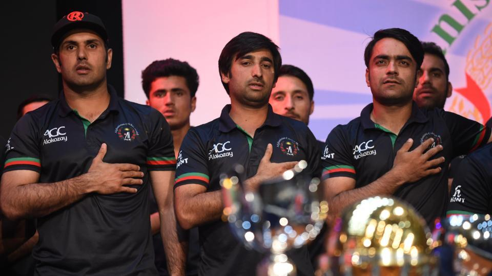The team walked along a red carpet flanked by an honour guard of Afghan children in traditional dress. (AFP)
