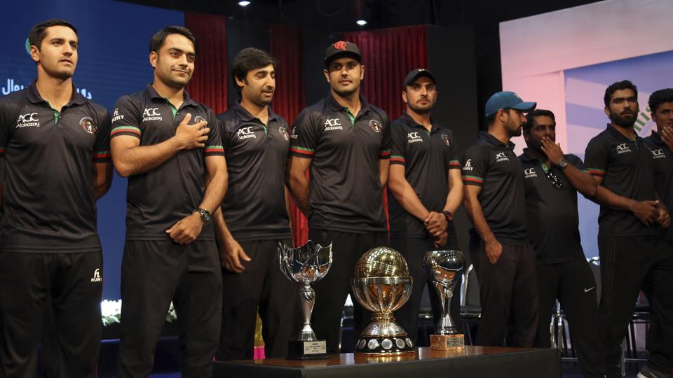 Afghanistan cricket  team players stand with trophies after winning 2019 ICC World Cup qualifiers. (AP)