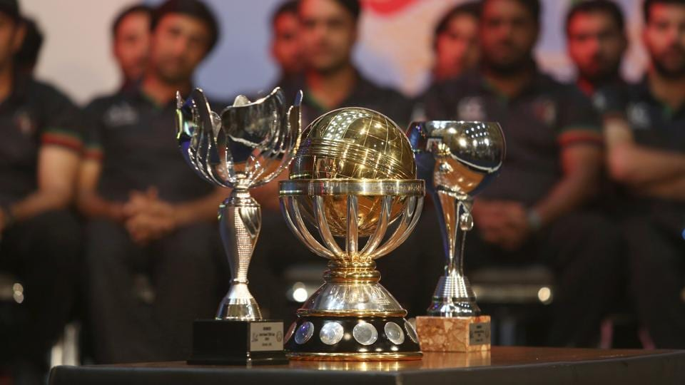 The ICC World Cup qualifier trophies placed in front of the cricketers. (AP)
